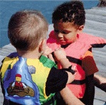 Children putting on life jackets