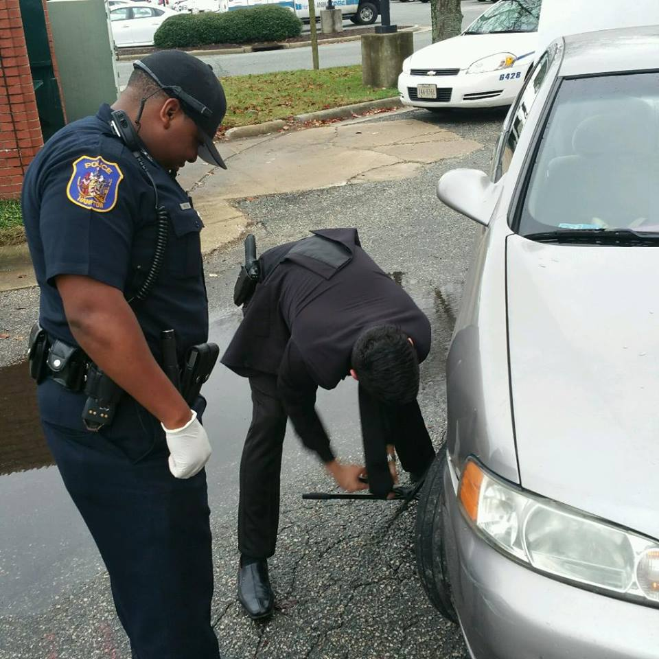 Officers Work on Changing a Tire