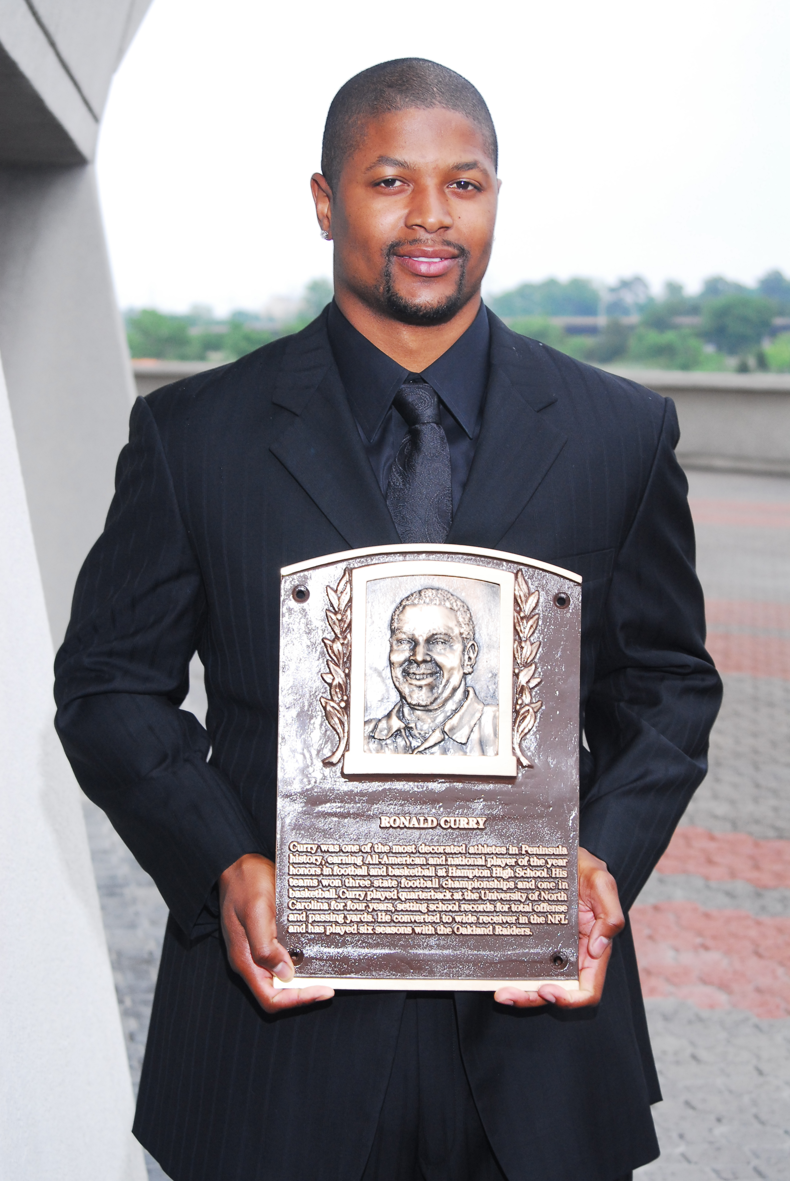 Ronald Curry with Bronze Plaque